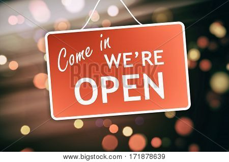 We Are Open Sign On Abstract Background