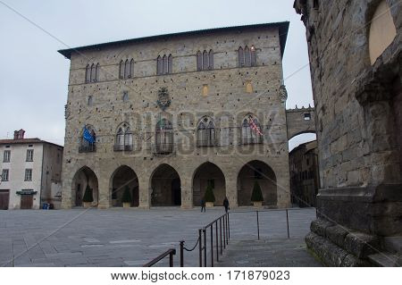 Italy Pistoia - November 27 2016: the view of Piazza del Duomo with the Palazzo del Comune City Hall Municipial museum of Pistoia on November 27 2016 in Pistoia Tuscany Italy.