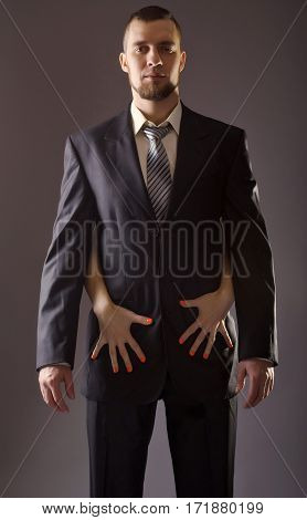 A Bearded Man In A Suit And The Woman's Hand With Red Nail Polish.