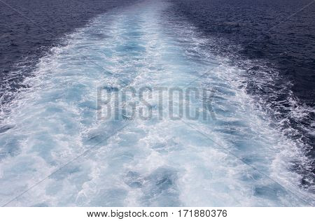 Sea background image with white foamy wave. Ferry travel. Bubble tail after cruise ship. Deep ocean view. Big ship pitching image. White water wave in the sea. Look to the seaside