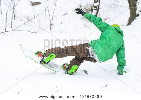 Athletic Man Snowboarding On Ski Slope.