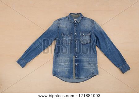 Jean shirt–wooden background
