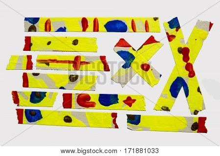 A set of yellow abstract-style painted masking tape pieces