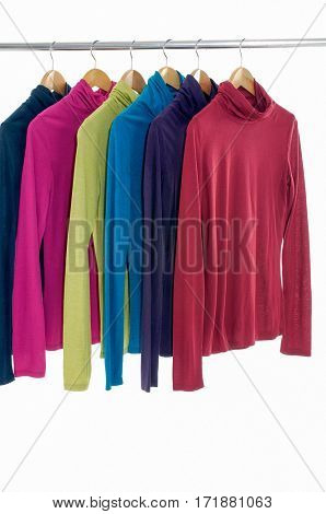 female colorful clothing hanging on hangers