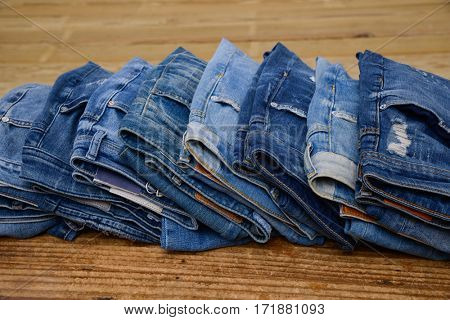 Set of blue jeans on old rustic wooden.