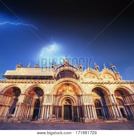 Beautiful view of the sky with lightning. Patriarchal Cathedral Basilica of Saint Mark at St Mark's Square. Venice, Italy