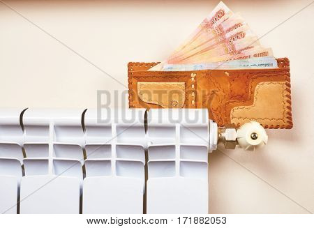 Radiator Adjustment To Save Energy. Save Energy And Money Concept