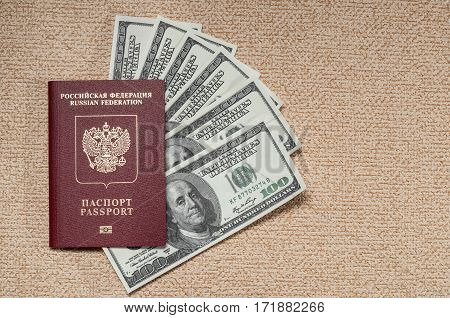 Russian passport and dollar bills on the table