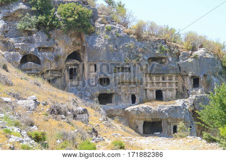 The picture was taken in Turkey. The picture shows the entrance to the ancient city of numerous caves.