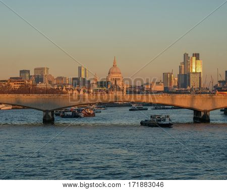 London skyline shot which includes Waterloo bridge and looks towards St. Paul's Cathedral. A central river shot.