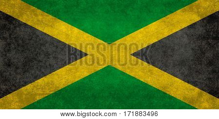The National flag of Jamaica with worn distressed grungy textures