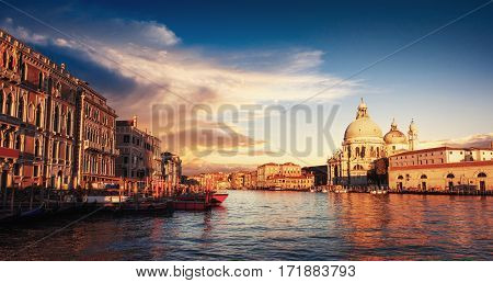 Fantastic views of the Grand Canal and the Basilica Santa Maria della Salute. Many tourists who visit beauty all year round. Italy. Venice, Italy. Europe