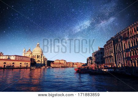 Fantastic views of the Grand Canal and the Basilica Santa Maria della Salute. The starry sky and the Milky Way. Italy. Venice, Italy. Europe