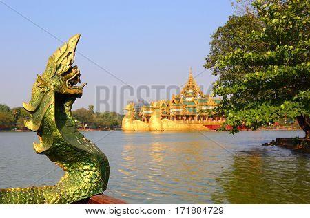 Head of snake and Floating Barge Karaweik in Yangon, Myanmar (Burma)