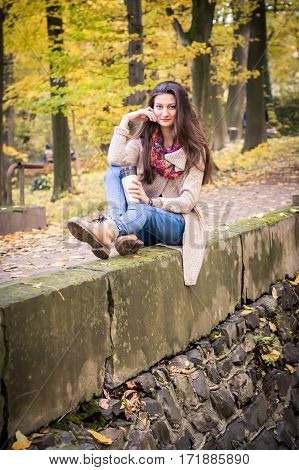 girl sitting on the concrete stone in the Park