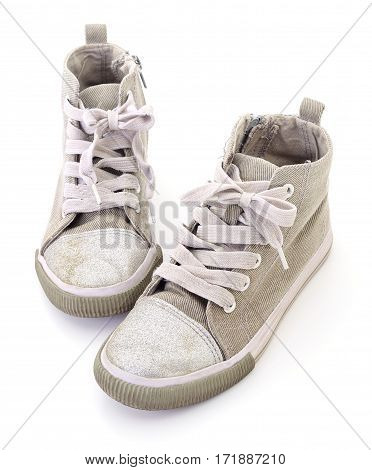 Child's textile shoes isolated on white background.