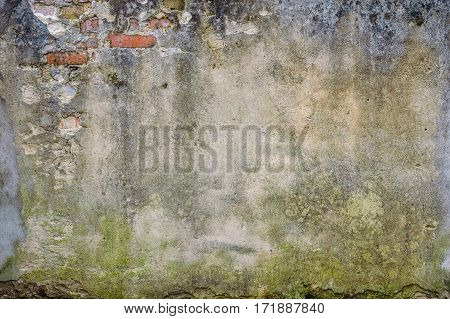 grunge textured background. brick wall of the old house. remains of old plaster