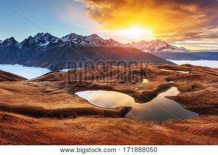 Sunset on mountain lake Koruldi. Upper Svaneti, Georgia, Europe. Caucasus mountains