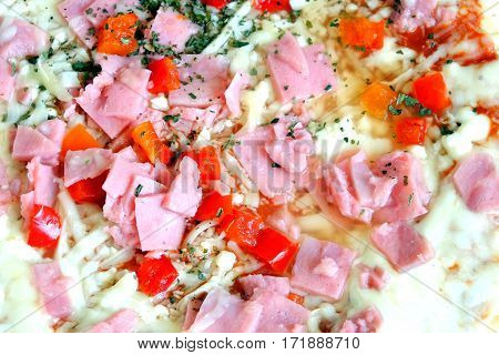 Prepared appetizing pizza with bacon and cheese with vegetables as background top view closeup