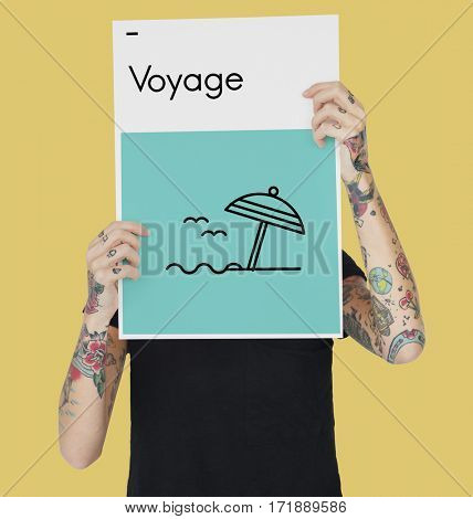 Woman holding banner of voyage word and icon