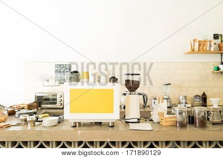 Empty coffee shop counter with an espresso machine grinder and many coffee brewers and grains