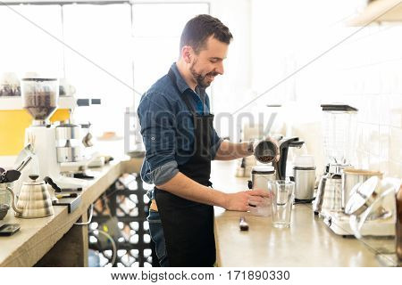 Happy Barista Making A Cup Of Coffee