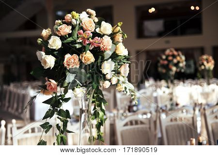 luxury decorated tables in the wedding hall. Wedding accessories.