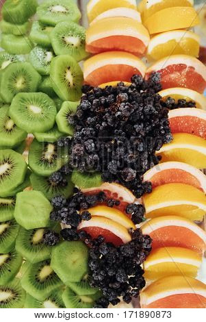 Different fresh fruits on the buffet table. Corporate event or wedding celebration.