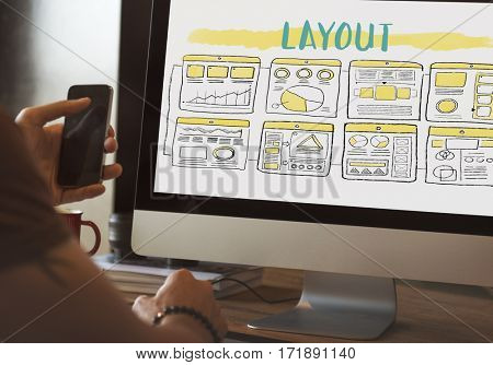 Web developer working on computer about layout concept