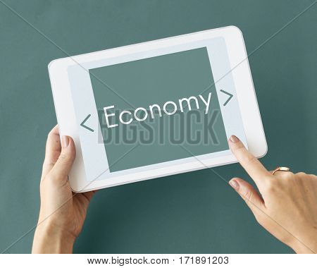 hand holding tablet with economy word on a screen