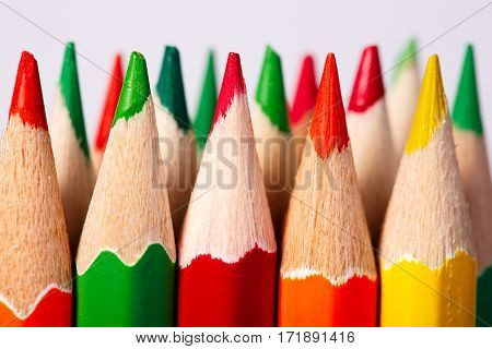 Color pencils of various color on a light background. Tips of the pencils. Standing. Craetive idea. Art and design. Painting and drawing. School and education.