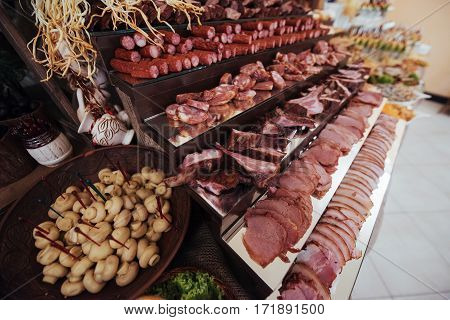 Basturma meat and ham cheese and mushrooms. Buffet table