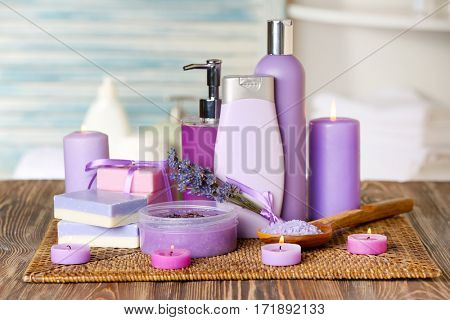 Set of body care cosmetics with lavender on wooden table
