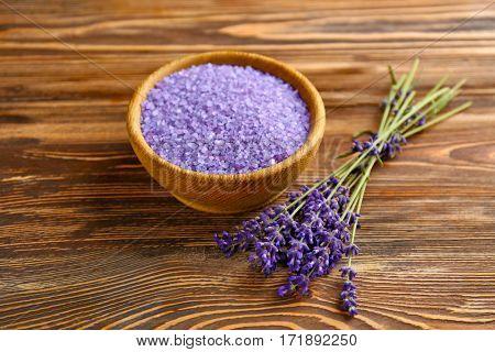 Sea salt with lavender on wooden background