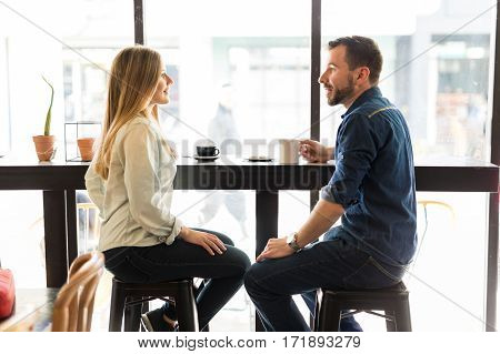 Couple Dating In A Coffee Shop