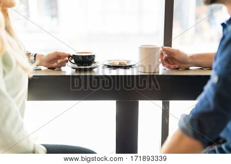Closeup Of A Couple Drinking Coffee