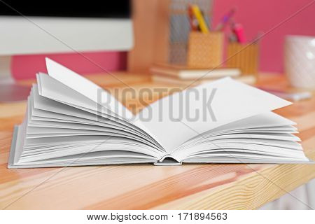 Opened book on office table, closeup