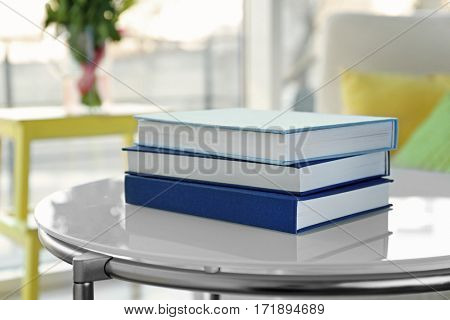 Pile of books on table at home
