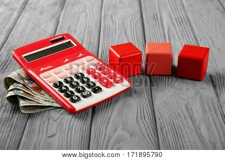 Wooden cubes with space for text and calculator on table