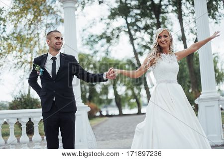 Happy young couple poses for photographers on her happiest day. Wedding day.