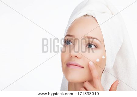 Beauty Woman face Portrait. Beautiful Blonde Spa model Girl with Perfect Fresh Clean Skin. Skin Care Concept Isolated on a white background