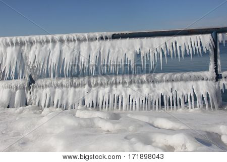 Icicles frozen on a railing from Lake Michigan