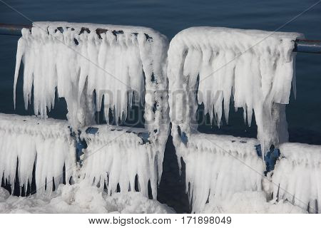 Lake Michigan water frozen on railings in Michigan