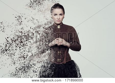 Woman in steampunk costume. Disintegration photo manipulation