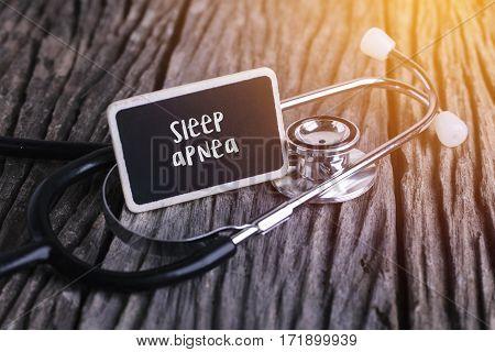 Stethoscope On Wood With Sleep Apnea Word As Medical Concept.