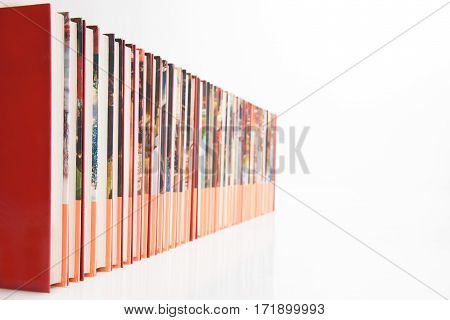 A long row of books on a white background