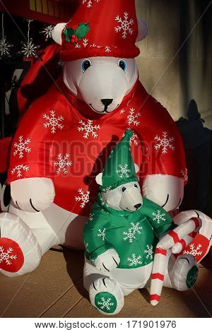 Inflatable toy Papa and Baby Polar Bears with red or green sweaters and hats at Christmas