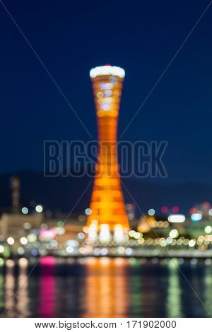 Abstract blurred bokeh Kobe port tower with twiligh sky background Japan