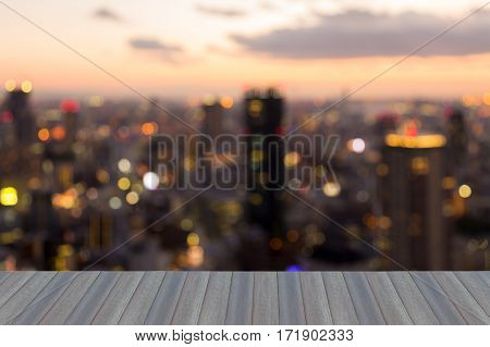 Opening wooden floor blurred bokeh lights city of Osaka central business downtown abstract background