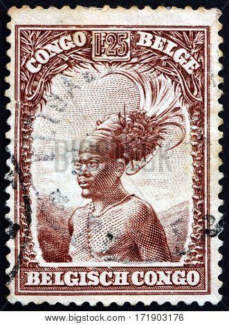 BELGIAN CONGO - CIRCA 1931: a stamp printed in Belgian Congo shows Mangbetu chief circa 1931